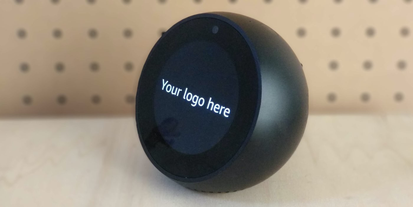 "Alexa Echo Spot with the text on the screen ""Your logo here"""
