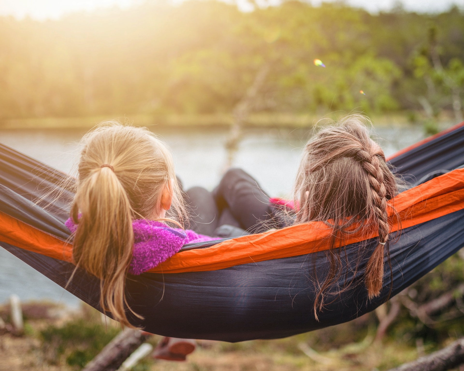 two people lying on a hammock together