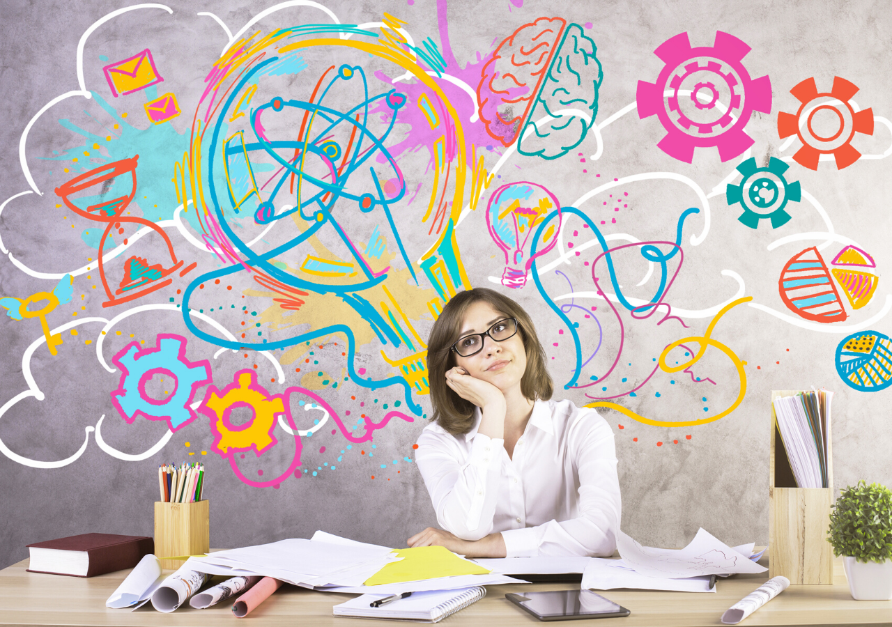 Attractive young woman at workplace generating creative ideas. Concrete wall with sketch in the background.