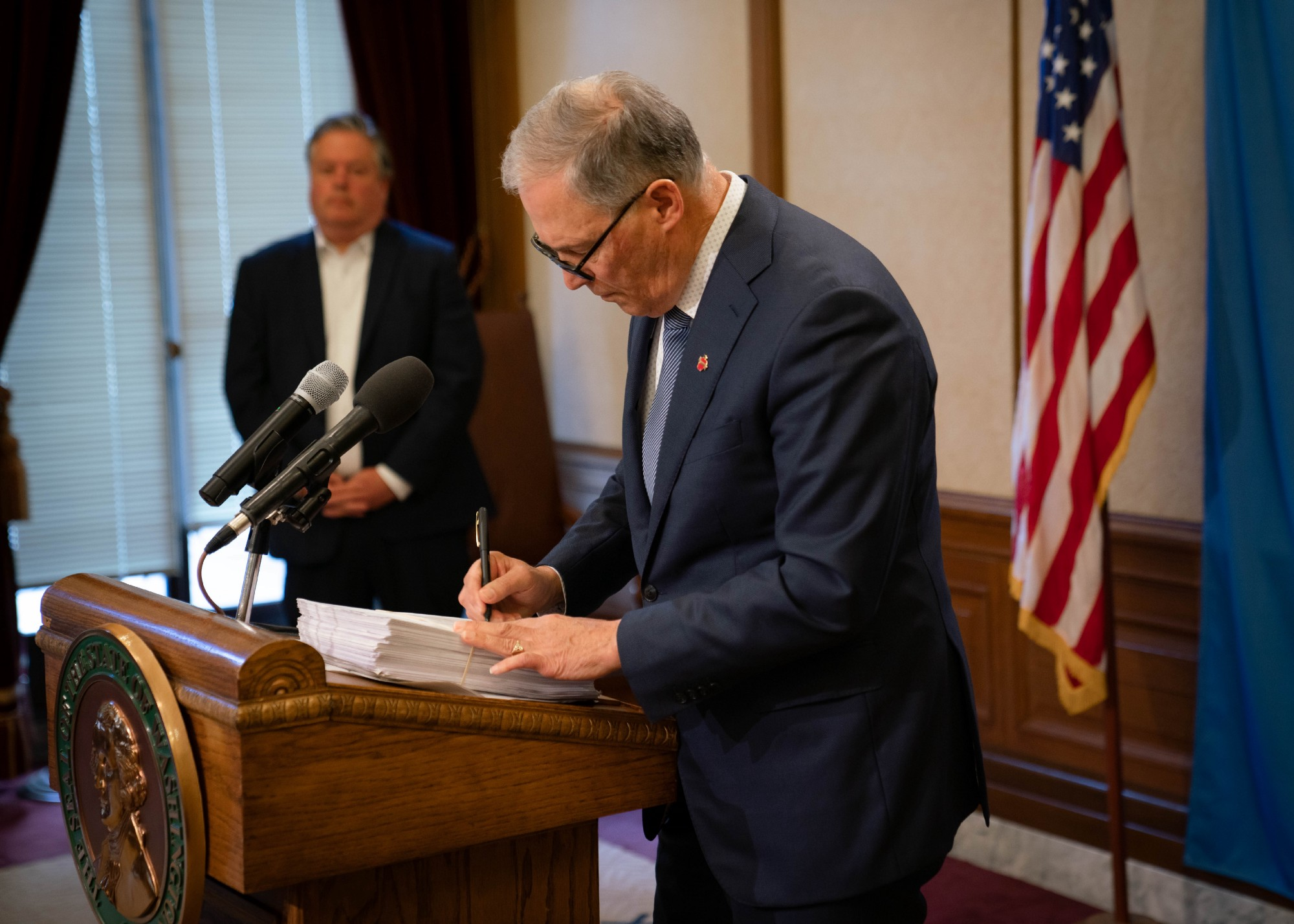 Gov. Jay Inslee signs the 2020 supplemental operating budget, April 3, 2020. (Office of the Governor)
