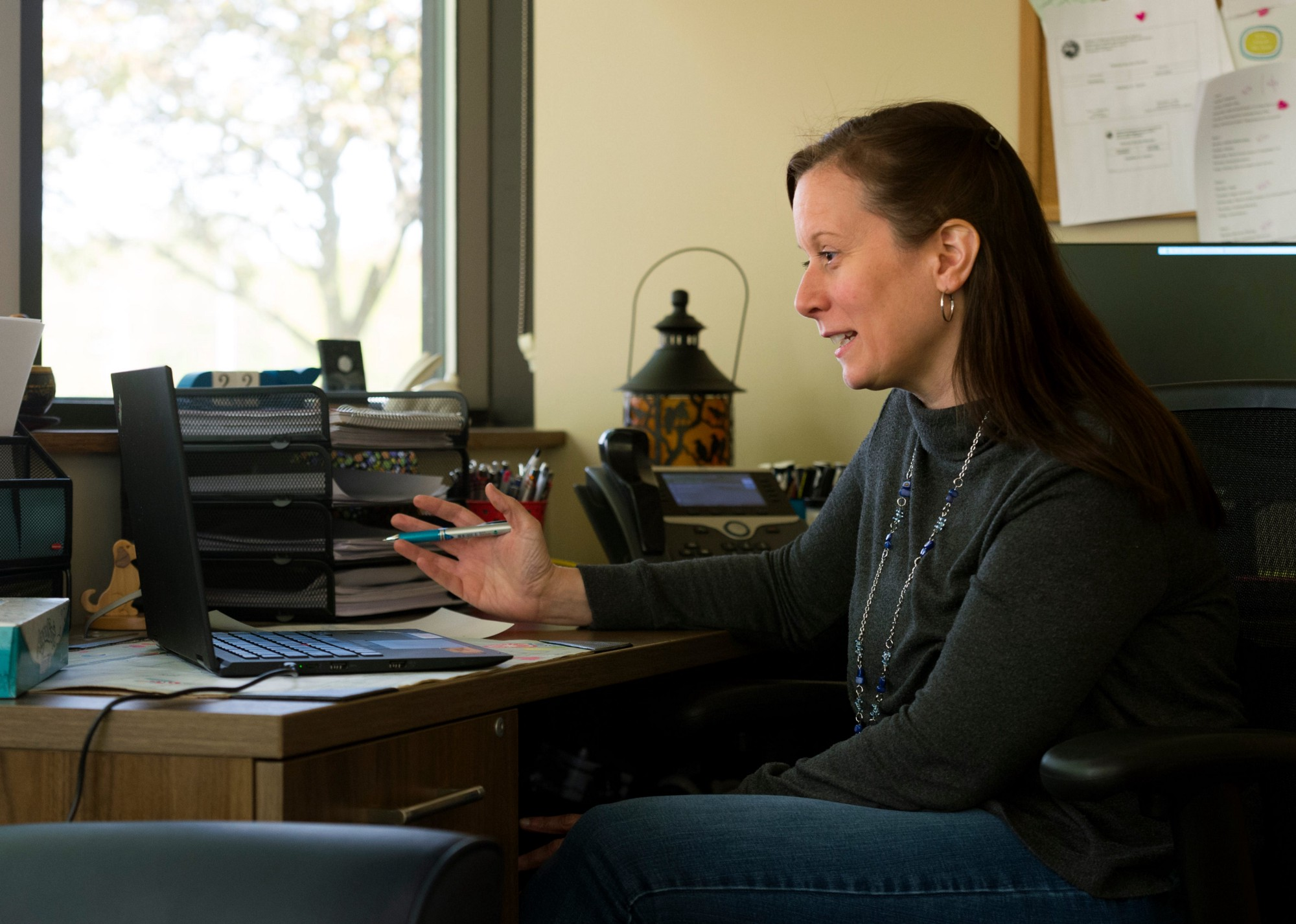Therapist Heather Guinn conducts a virtual session, April 22, 2020. Photo by MaCabe Brown/Courier & Press/Reuters