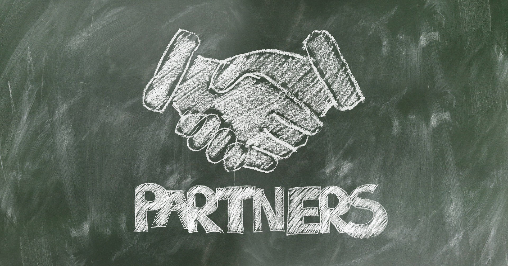 A chalkboard image of shaking hands.