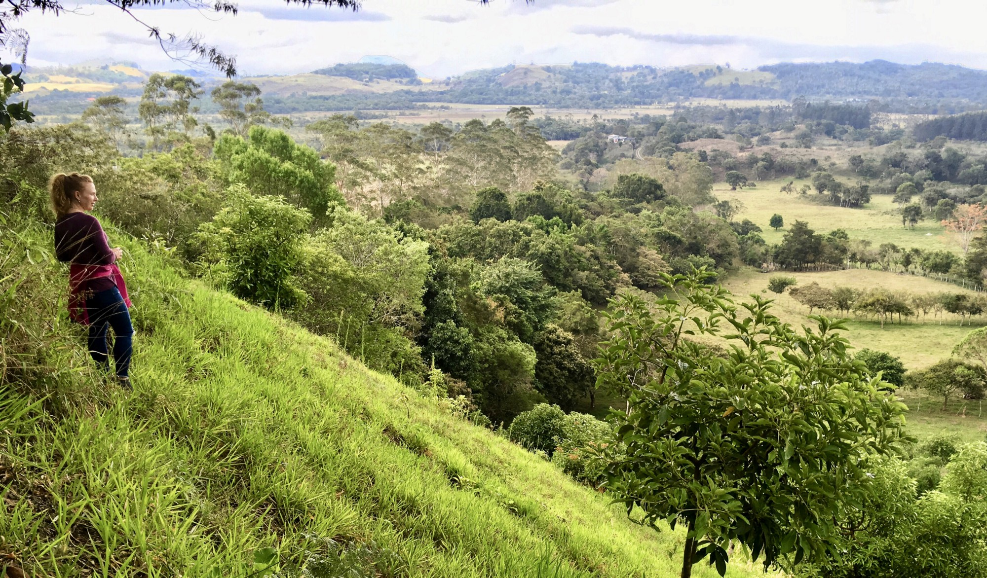 Rebecca Murauskas stands on Boquete Panama hill. Benefits of quitting job living internationally Expat life Move abroad FIRE