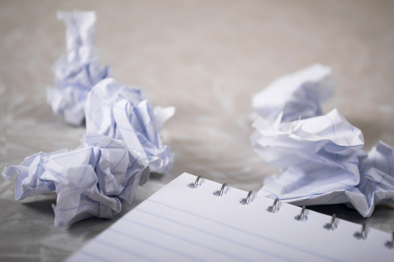 Notebook of paper with crumpled balls of paper