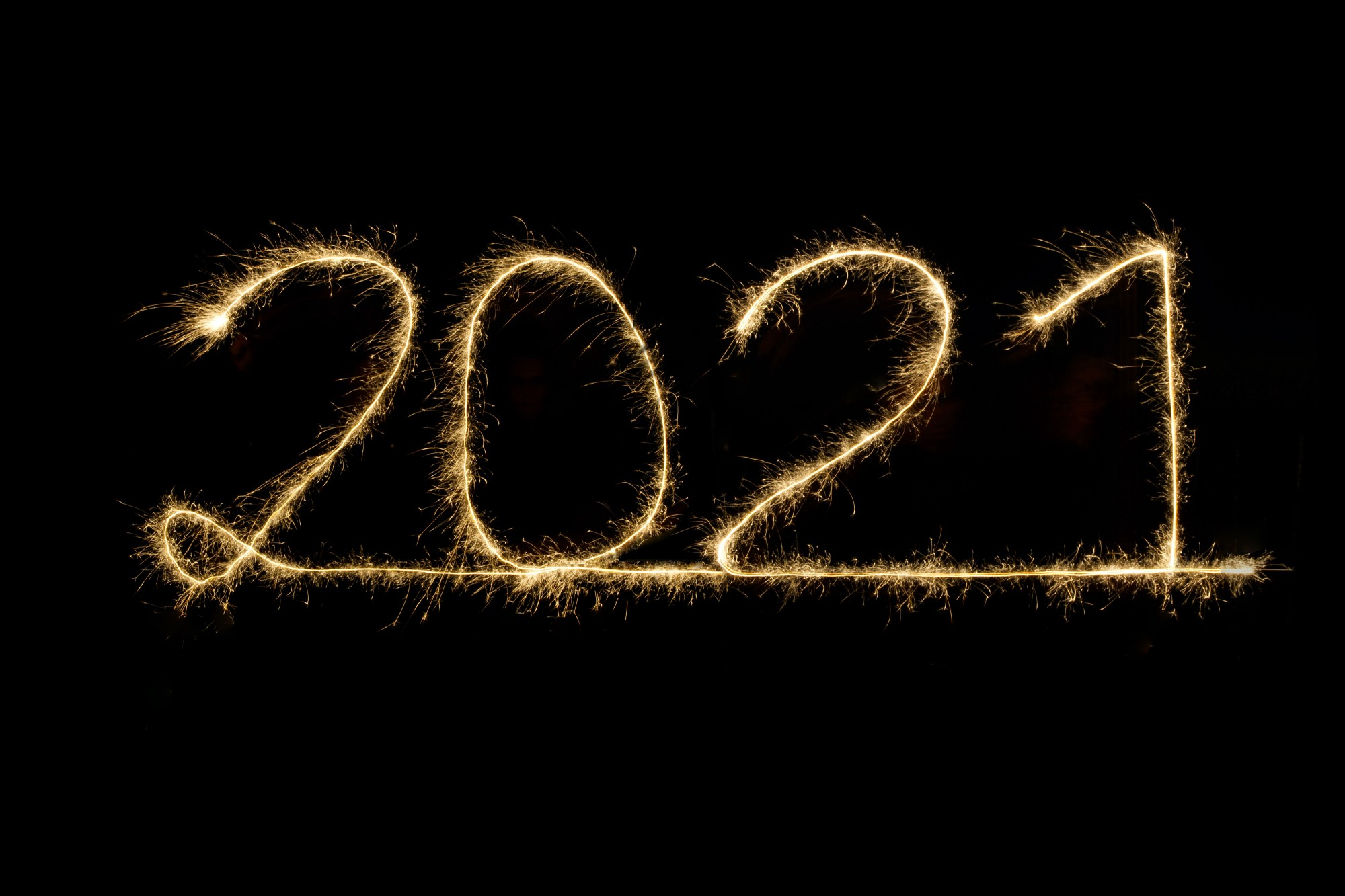 Roman numerals 2 0 2 1 written in gold sparkler light