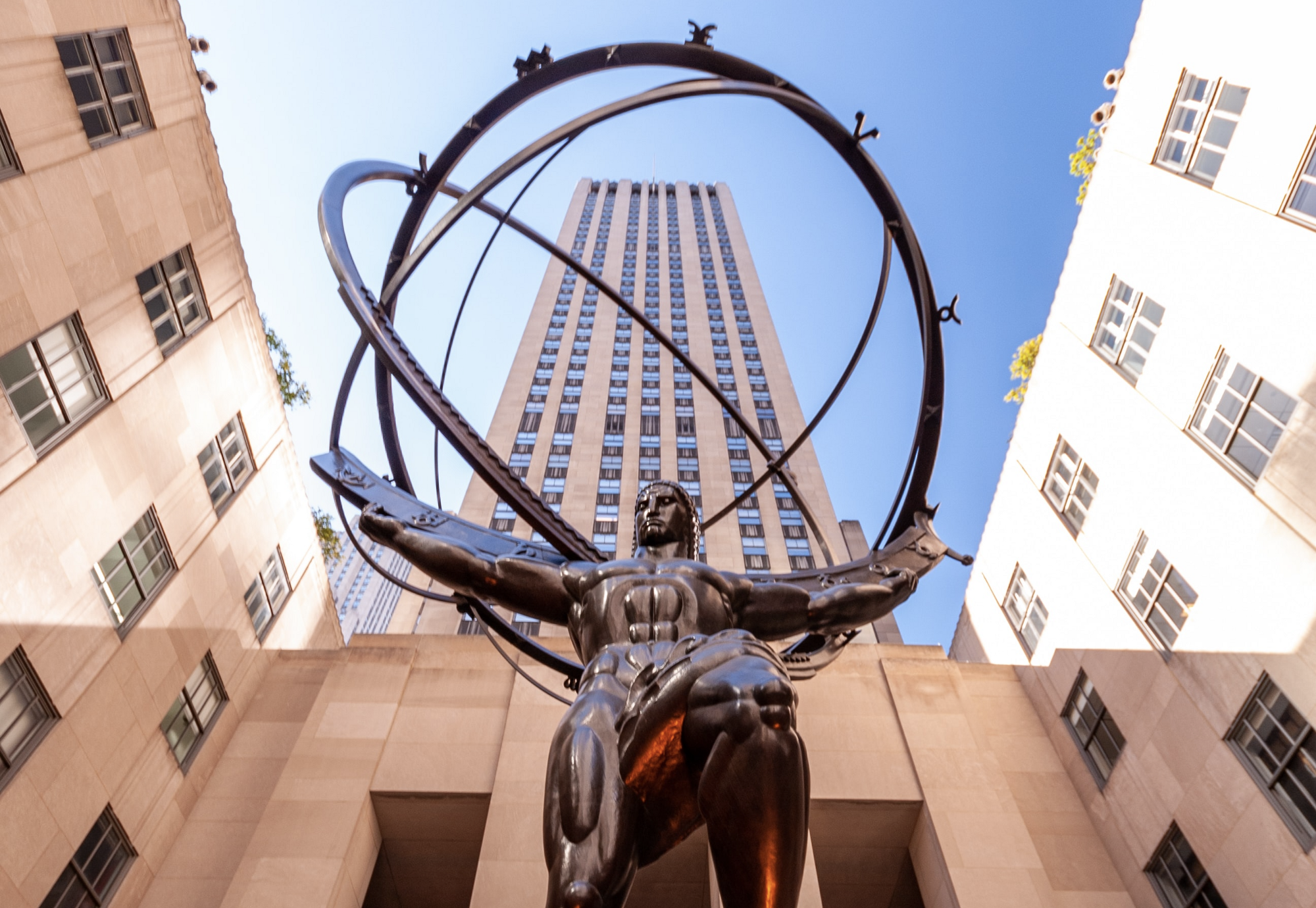 Sculpture of Atlas in front of Rockefeller Center. Photo by David Vives on Unsplash.