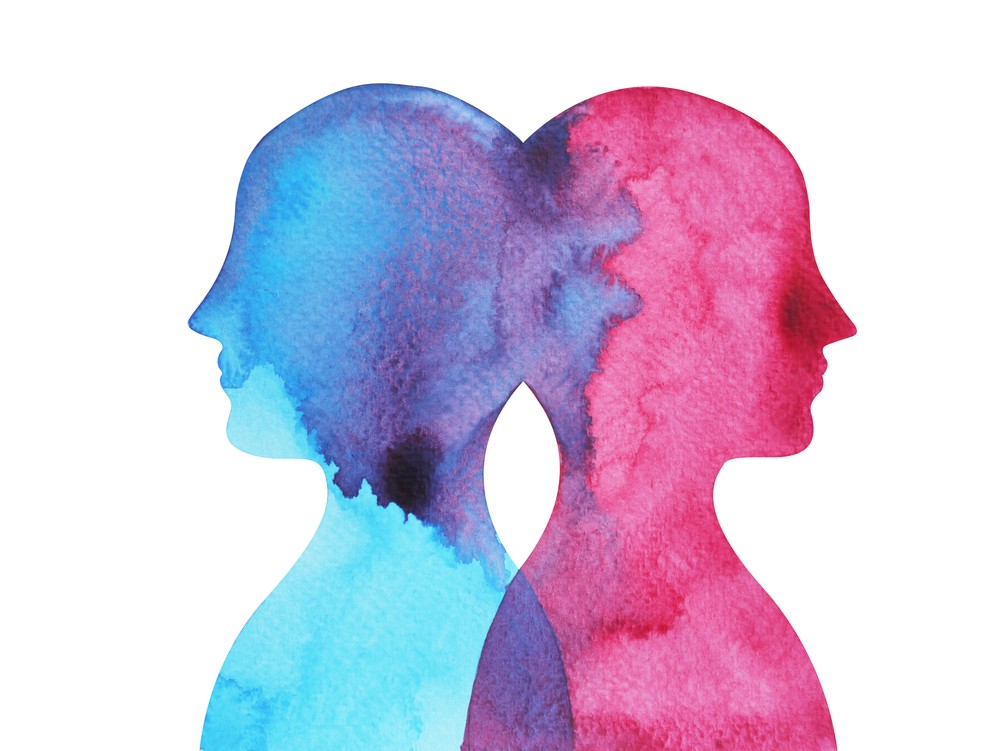 Two figures, blue and red, merging together