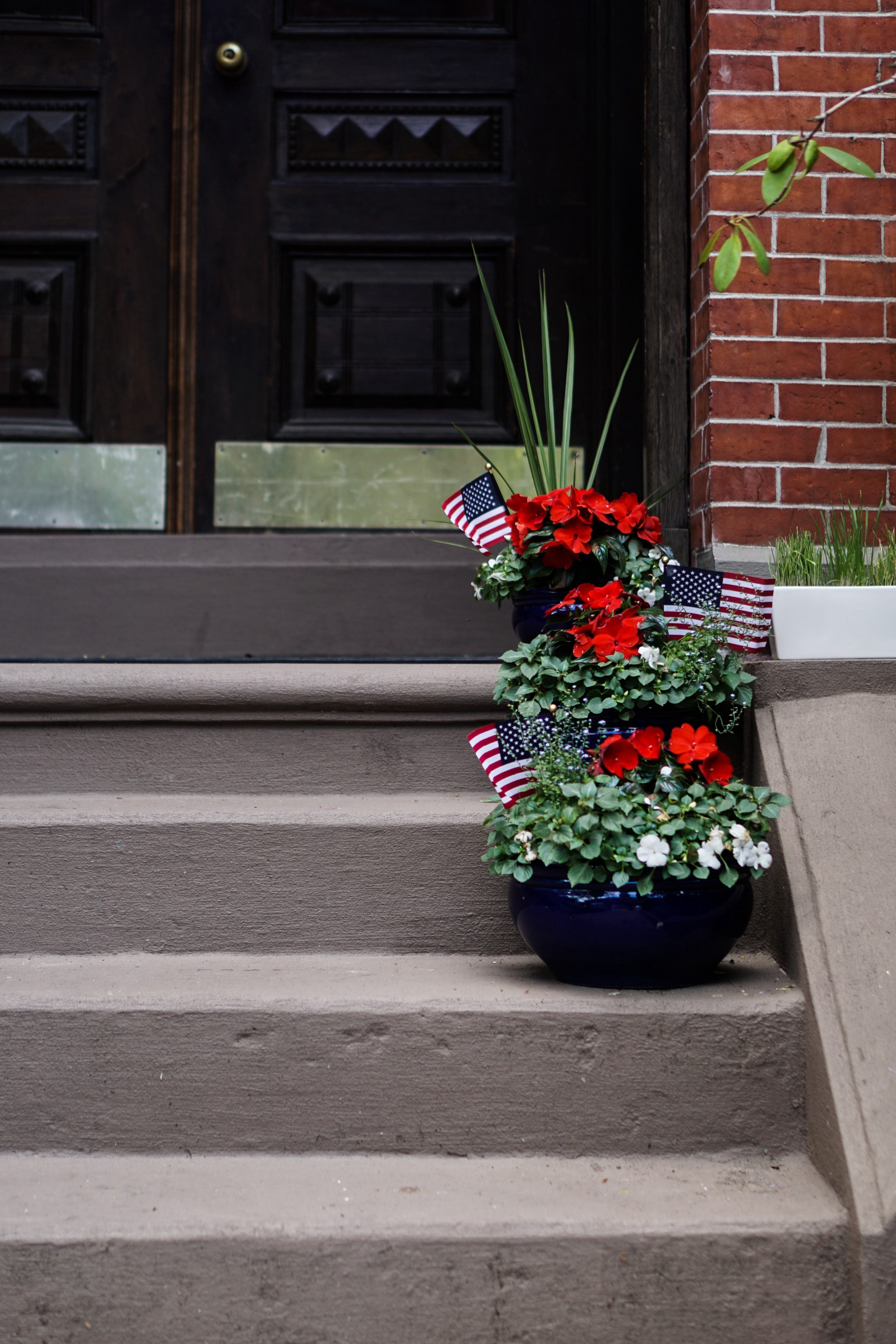 Memorial Day Flag and bouquets outside a home in South End, Boston