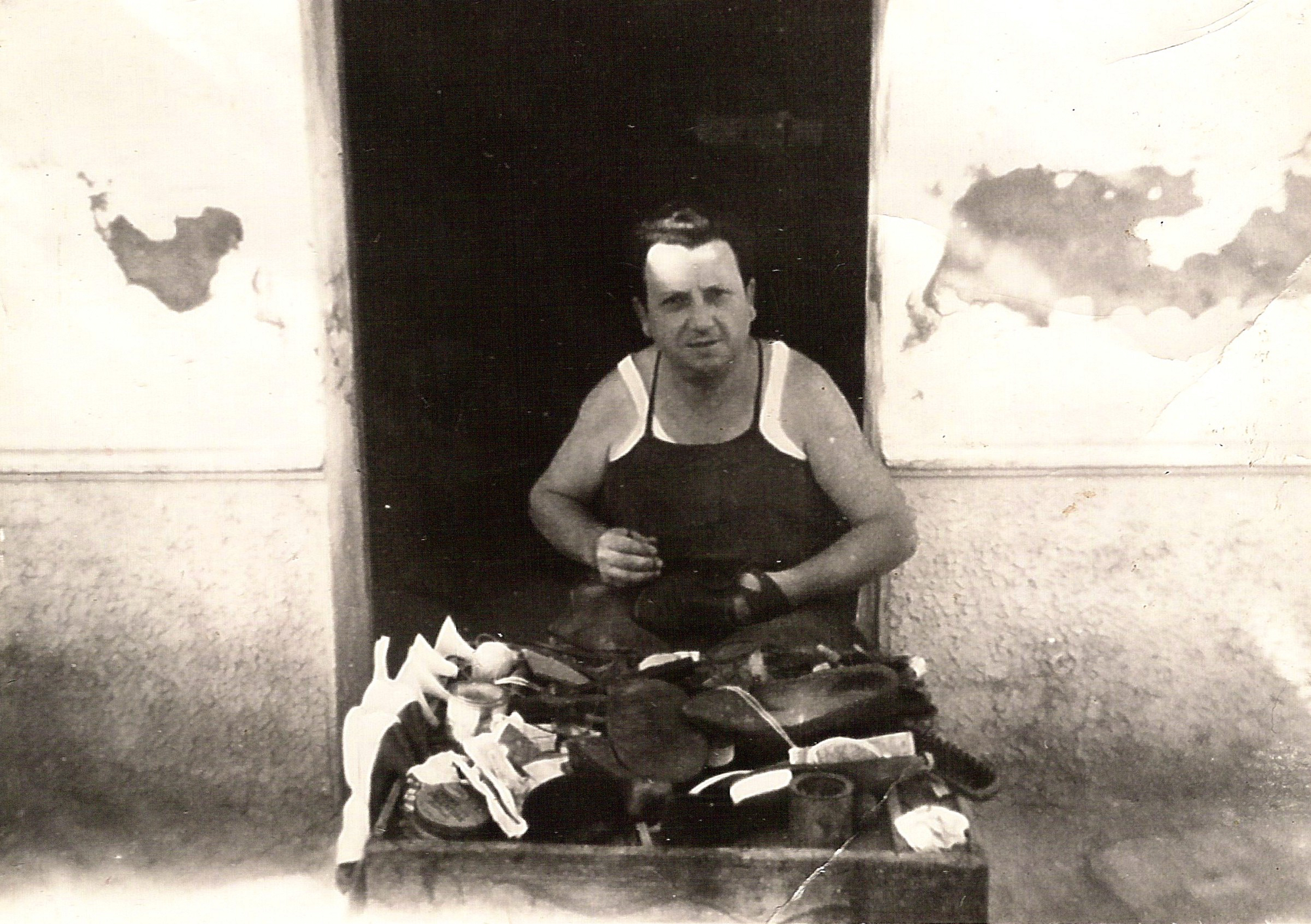 My grandfather, working outside his shop in the summer.