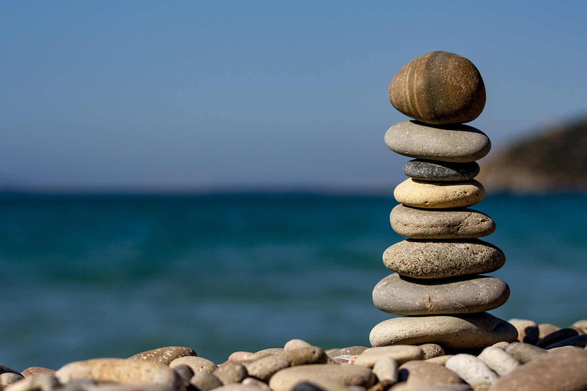 A balanced pile of stones on a beach