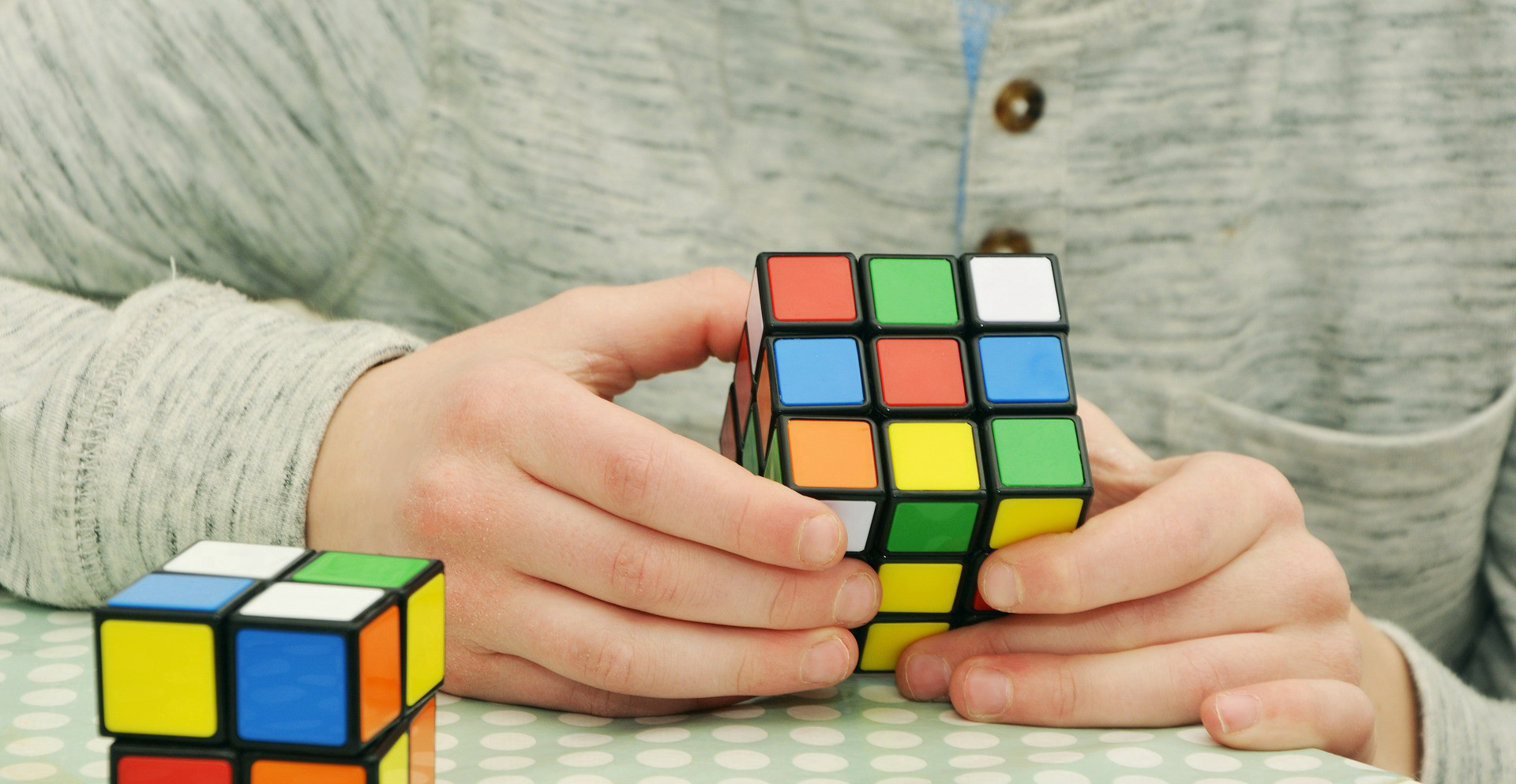 a person playing a rubik square game