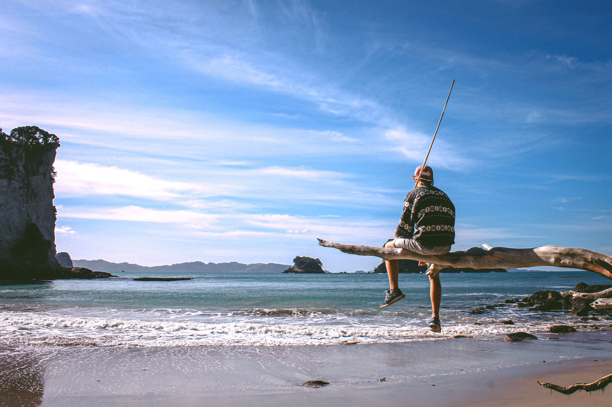 Surprisingly Simple Ways to Make Your Life Less Boring—man sitting on swing on a beach in New Zealand