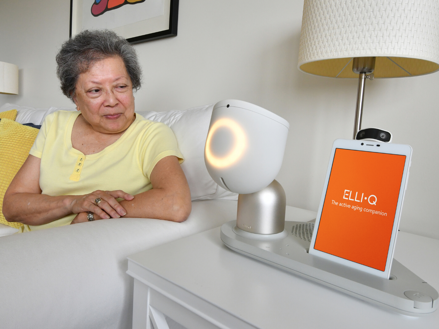 older adult using ElliQ