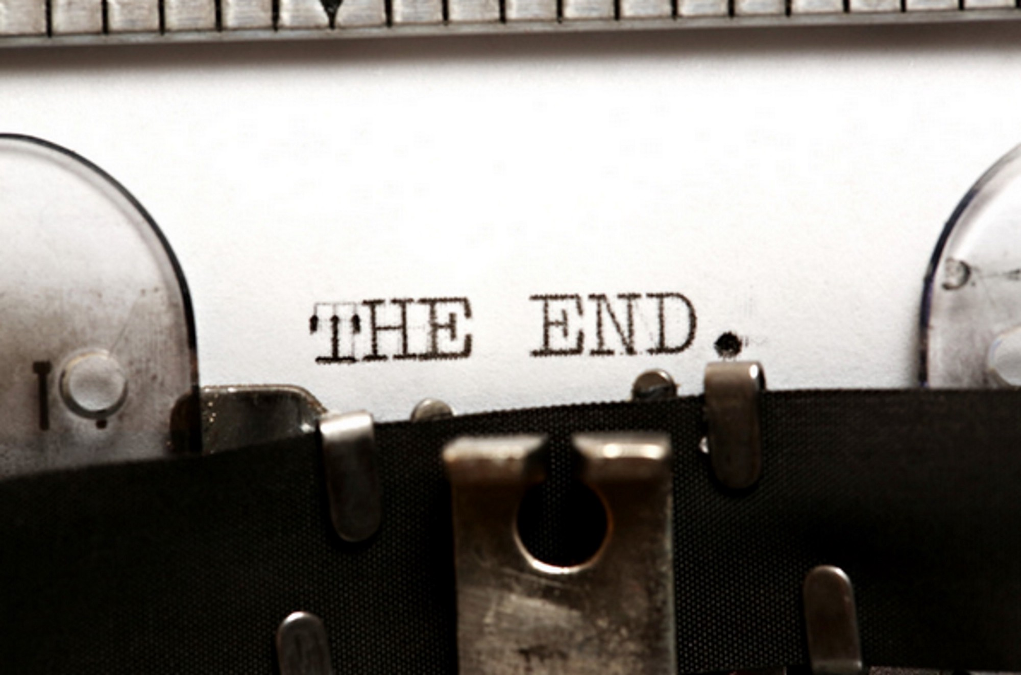 Photo of typewriter with the end—text on page