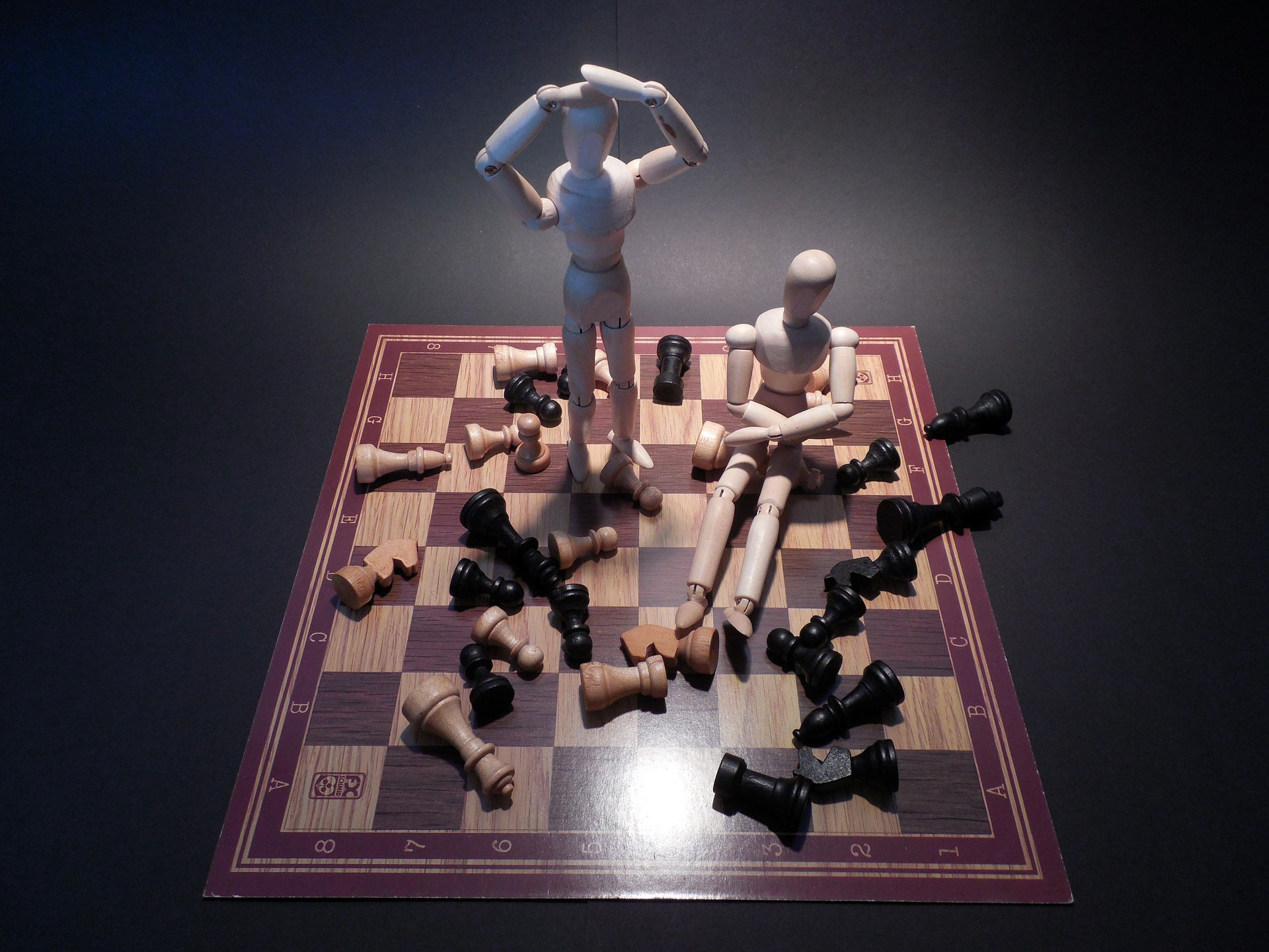 Frustrated wooden models on a chess board