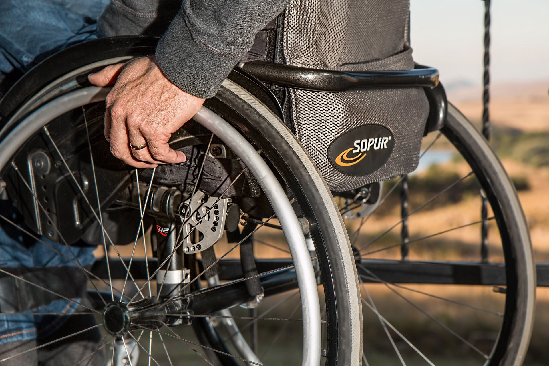 A close up picture of the side of a wheelchair
