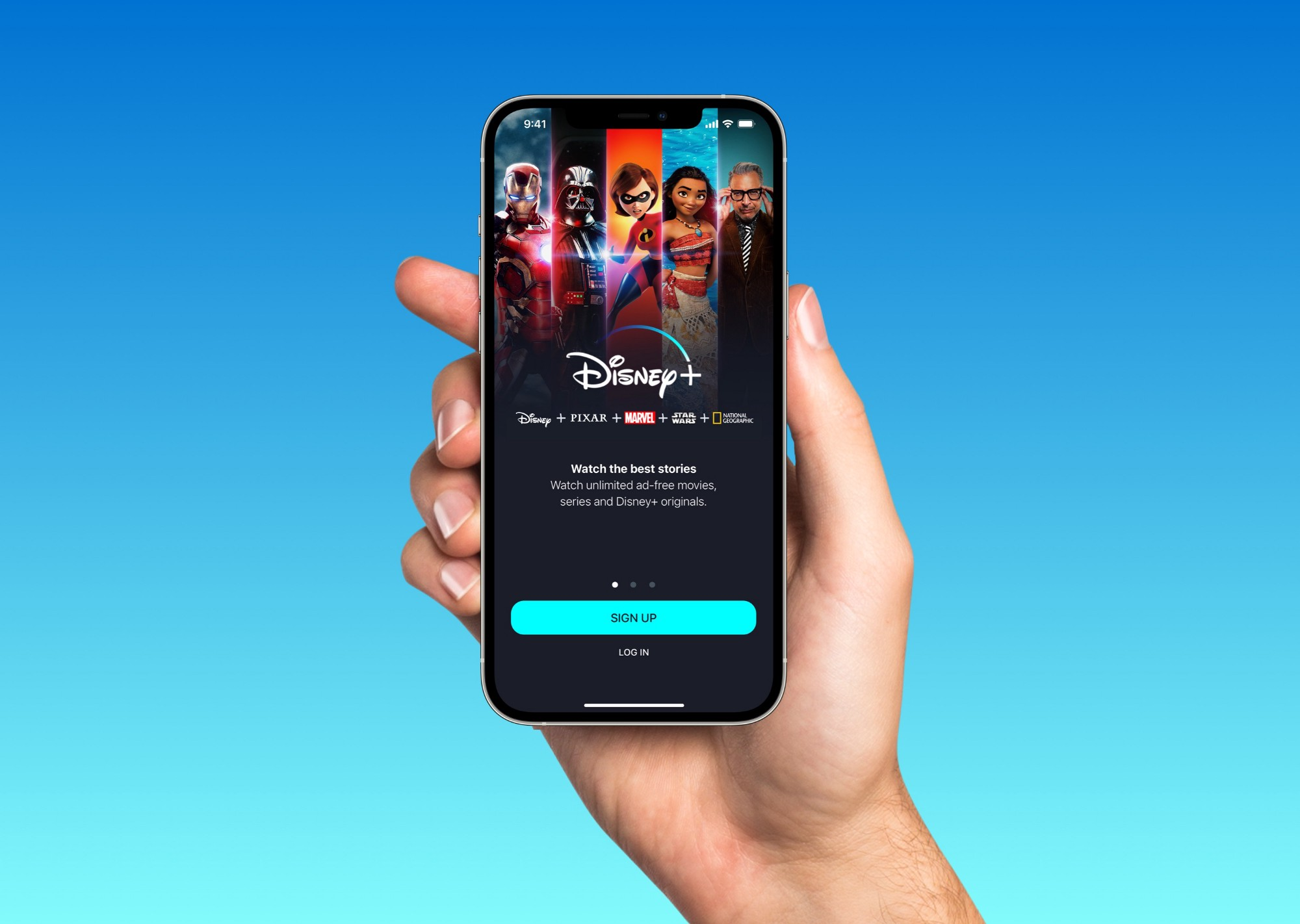 Man holding up an iPhone with the first screen of a redesigned Disney Plus app.
