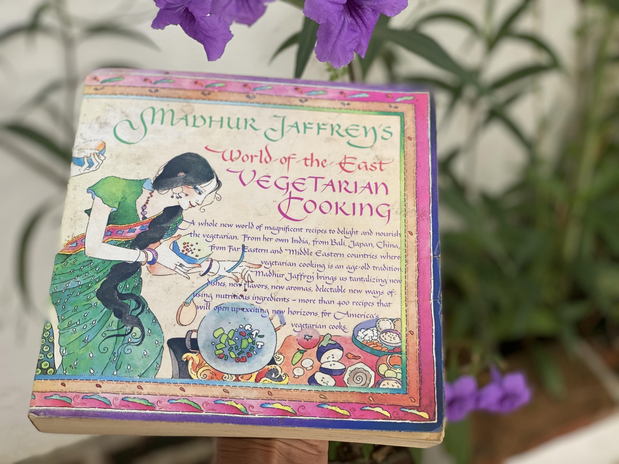 Madhur Jaffrey's World of the East Vegetarian Cookbook book cover is pictured, with an Asian-inspired font and illustration