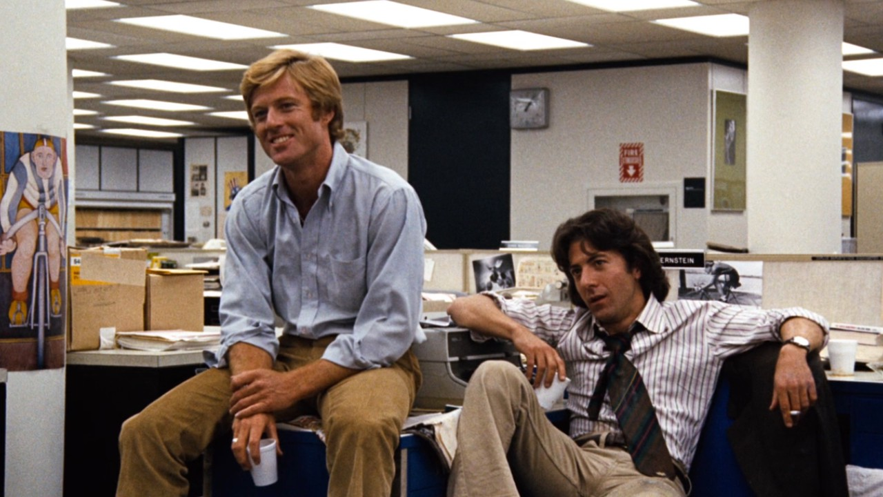 Carl Bernstein (played by Robert Redford) and Bob Woodard (played by Dustin Hoffman) sitting in The Washington Post's office.
