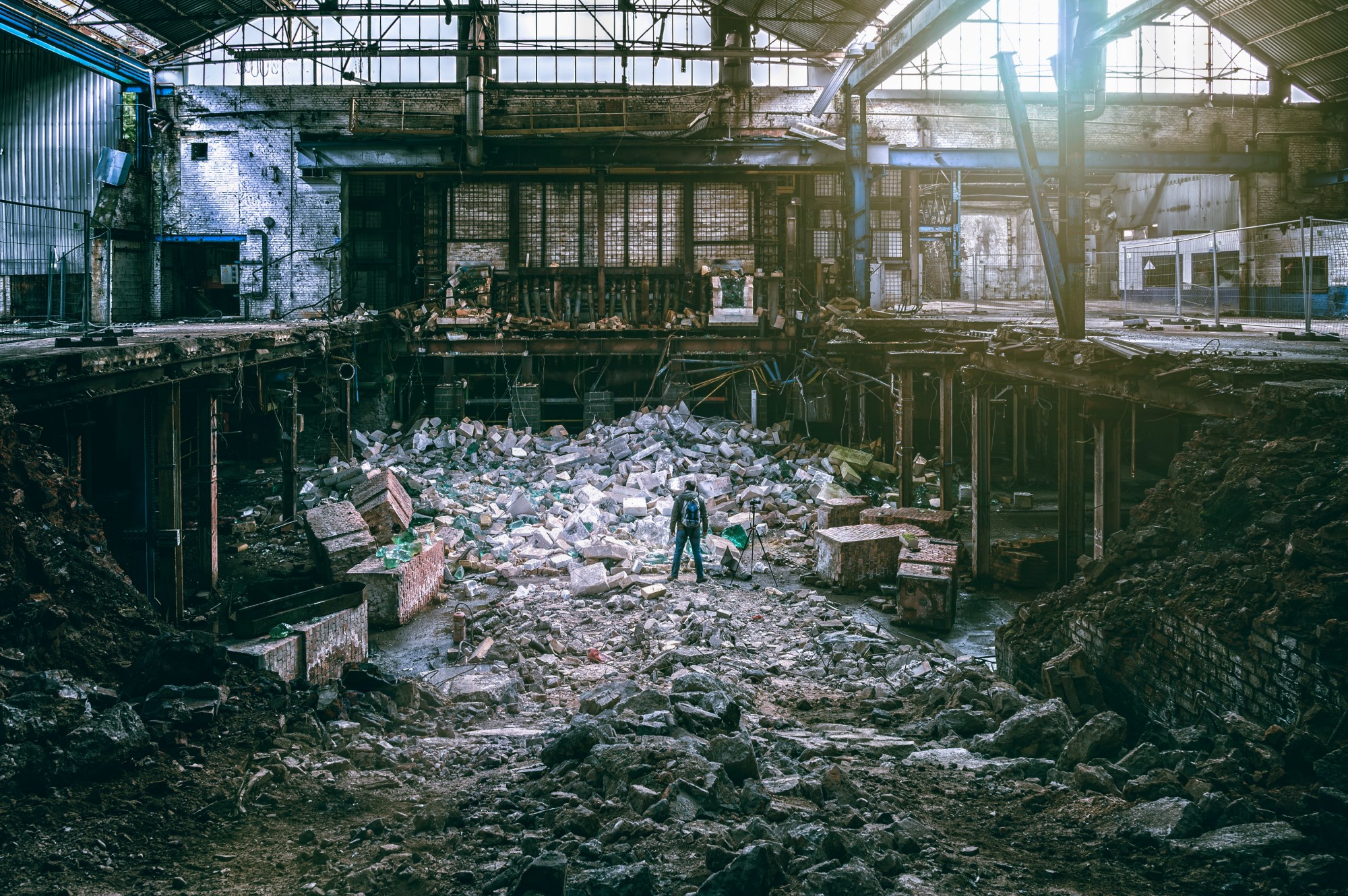 The demolished interior of what appears to have been a factory