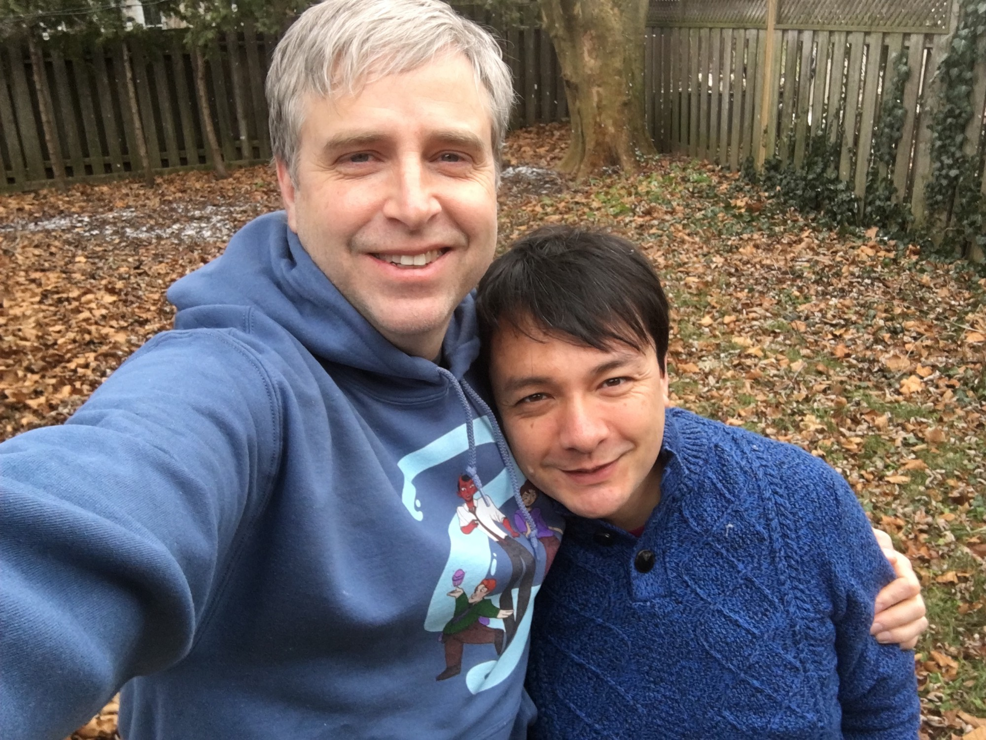 Eli and Sean taking a selfie together. Sean is wearing an other bothers sweatshirt and Eli a blue sweater.