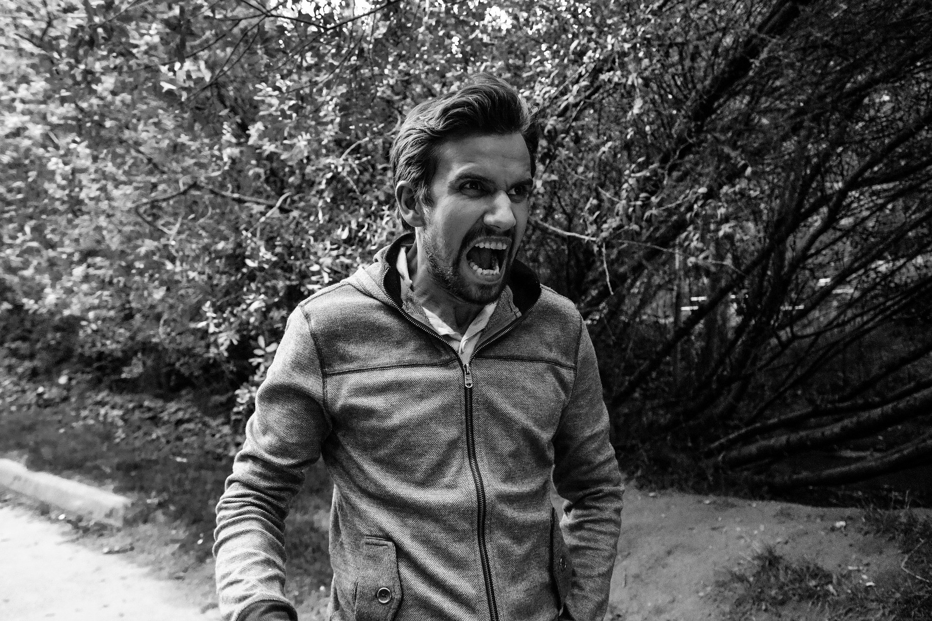 A black and white picture of an angry man