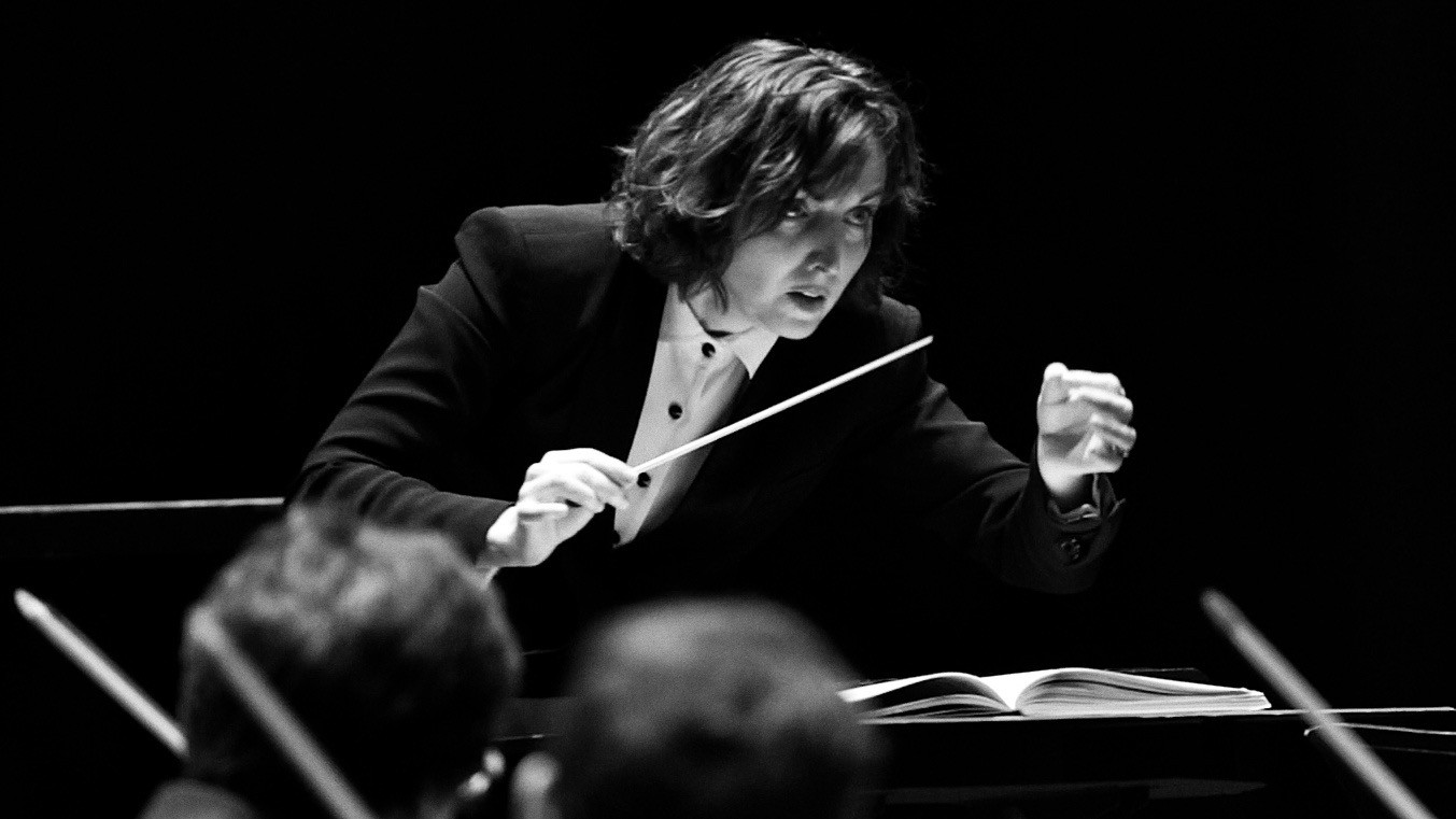 The author, a professional orchestra conductor, at work.