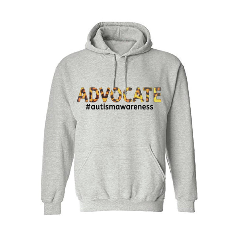 """A grey hoodie with """"Advocate #AutismAwareness"""" written across the front in yellow, orange and black."""