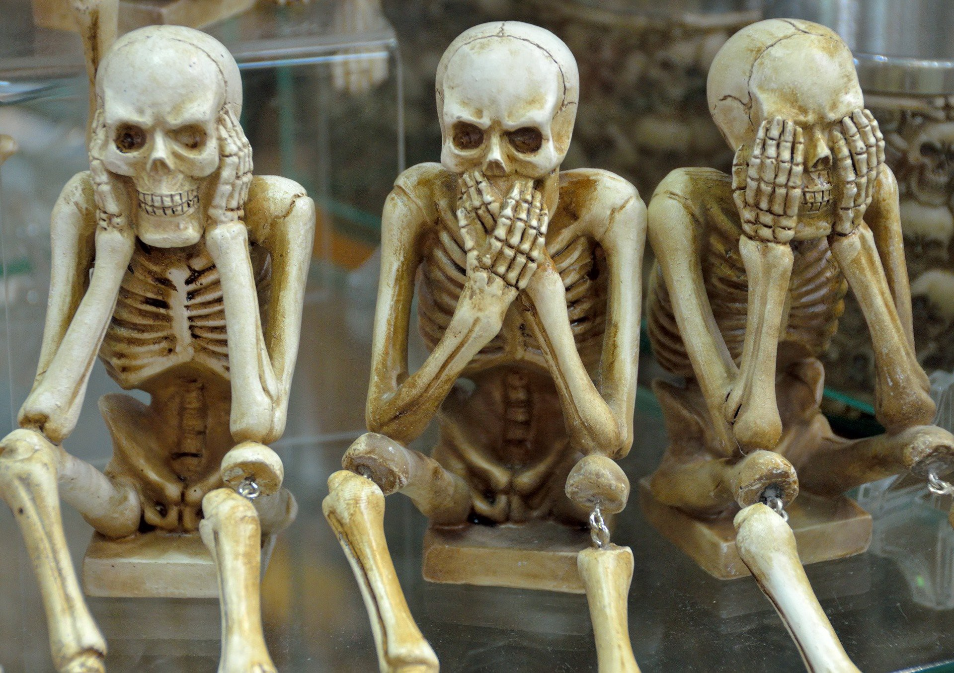 three skeletons in the hear no evil say no evil see no evil positions