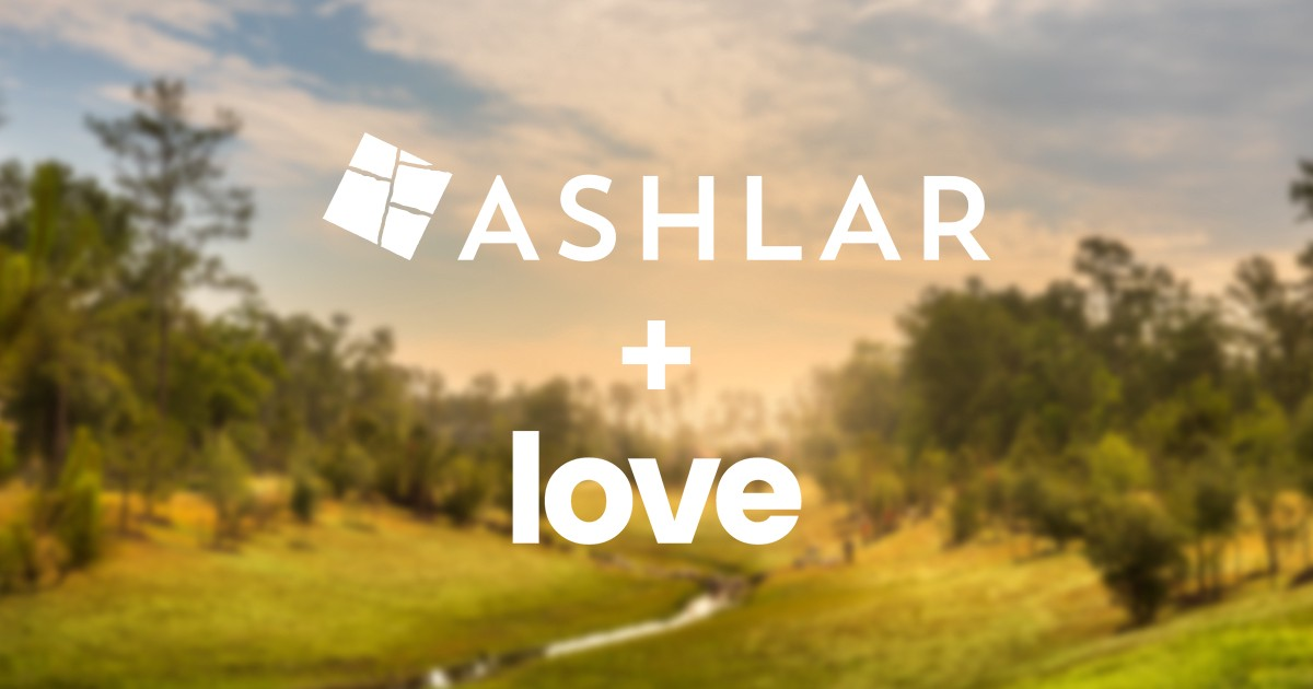 Ashlar Development Logo and Love Advertising Logo on a blurred nature background.