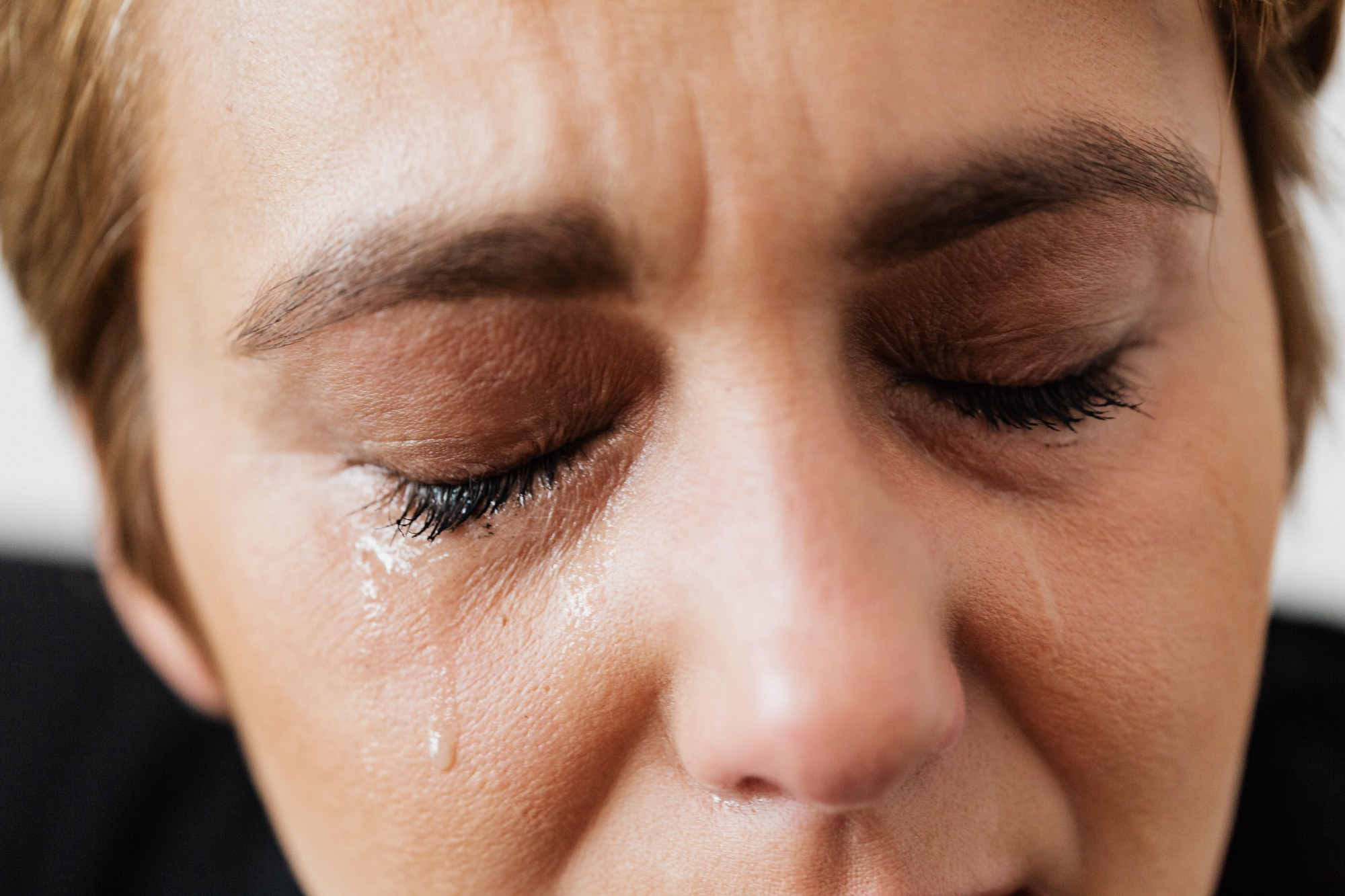 Close-up of woman's face with tears.