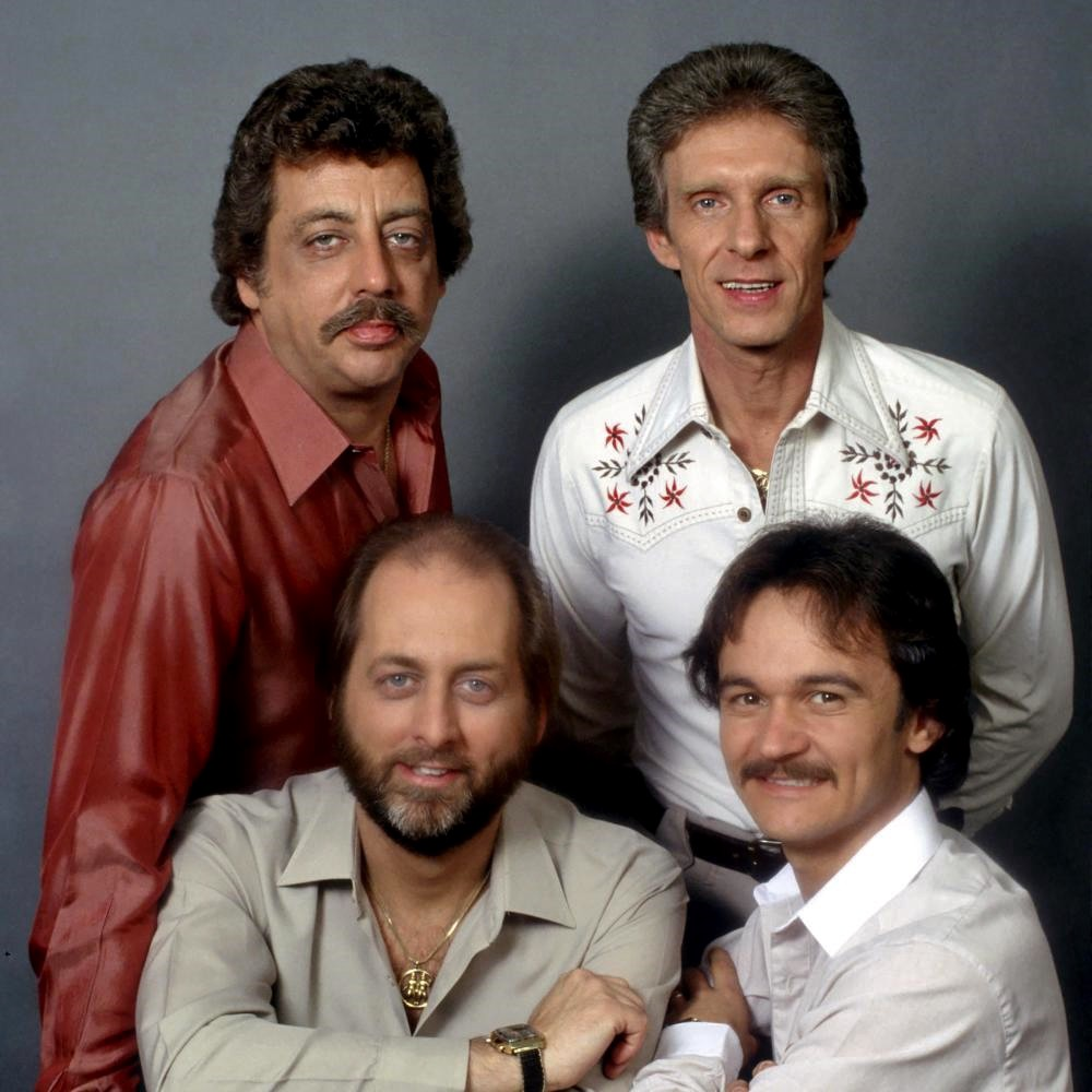 Bassist Harold Reid, baritonist Phil Balsley, tenor Jimmy Fortune, and lead singer Don Reid are the revamped Statler Brothers