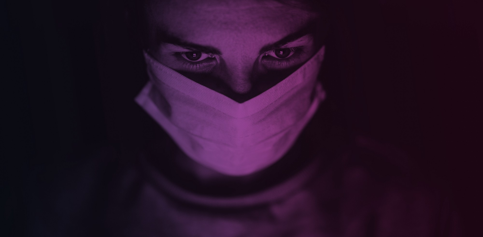 Man Wearing Face Mask In A Dark Room