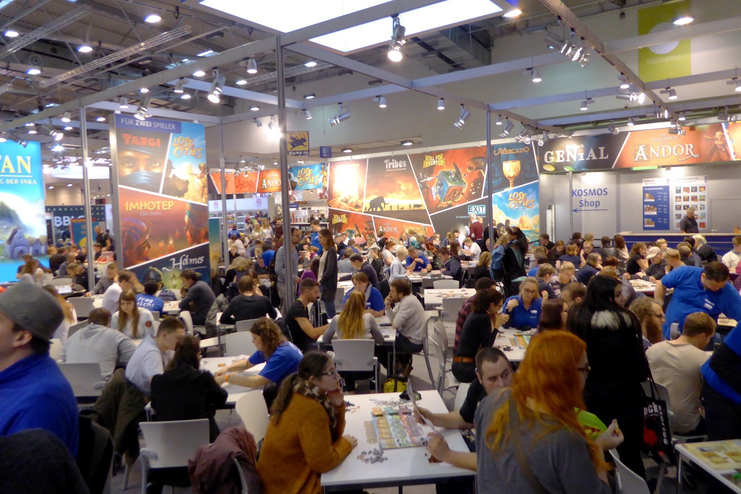 Visitors test playing board games at the stand of Kosmos (photo from 2018)