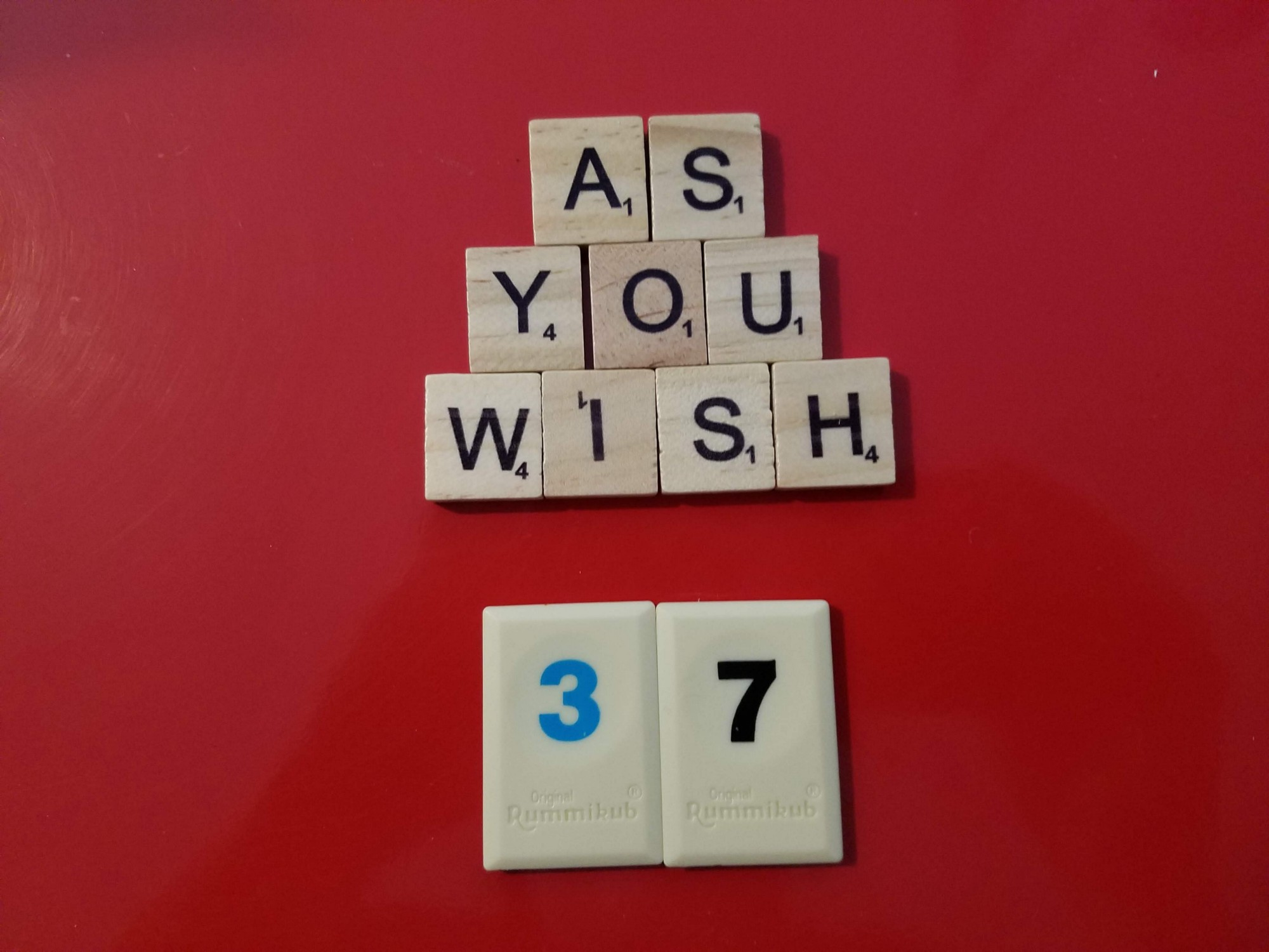 """Wooden and plastic tiles spelling out """"As you wish 37"""""""