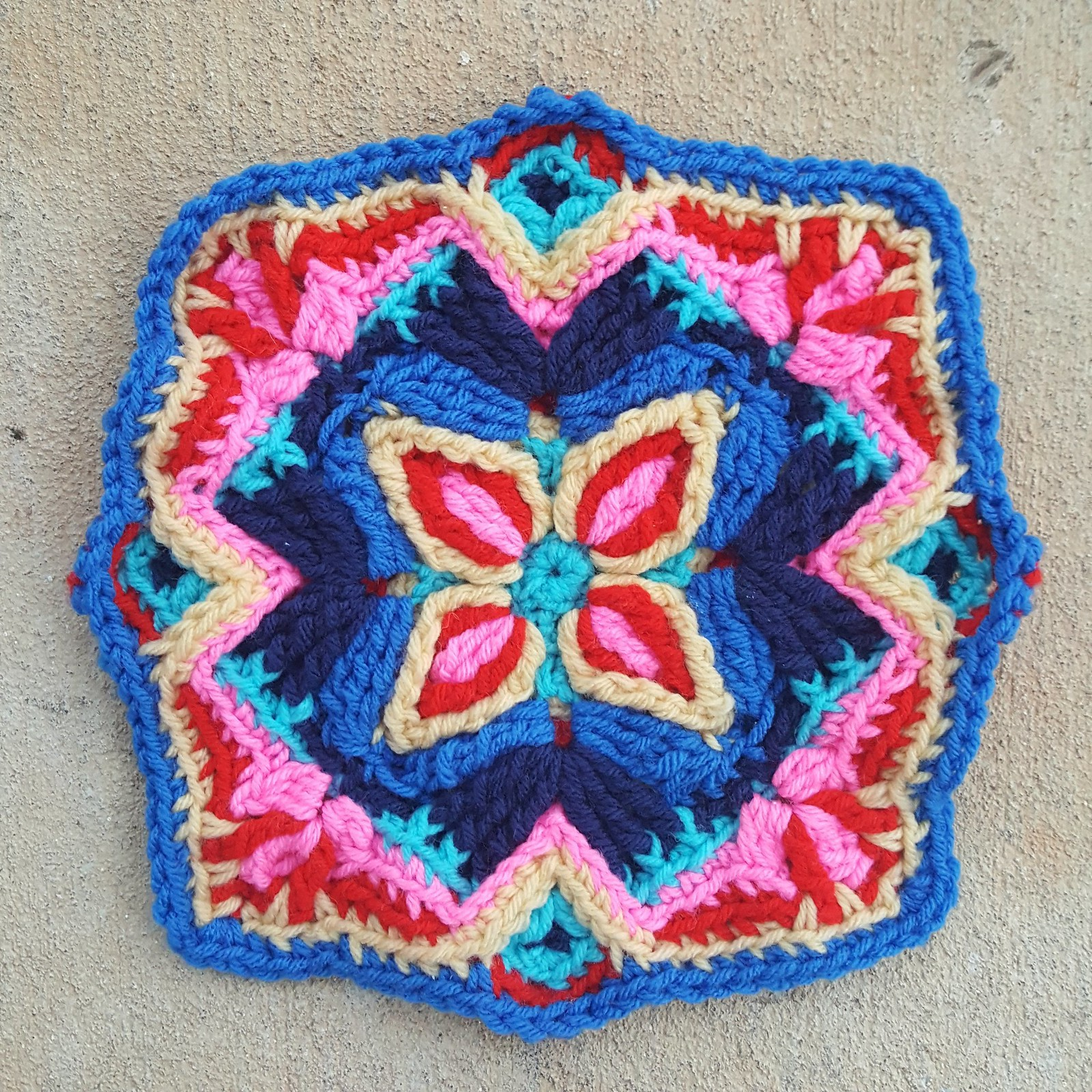A multicolor overlay crochet textured square