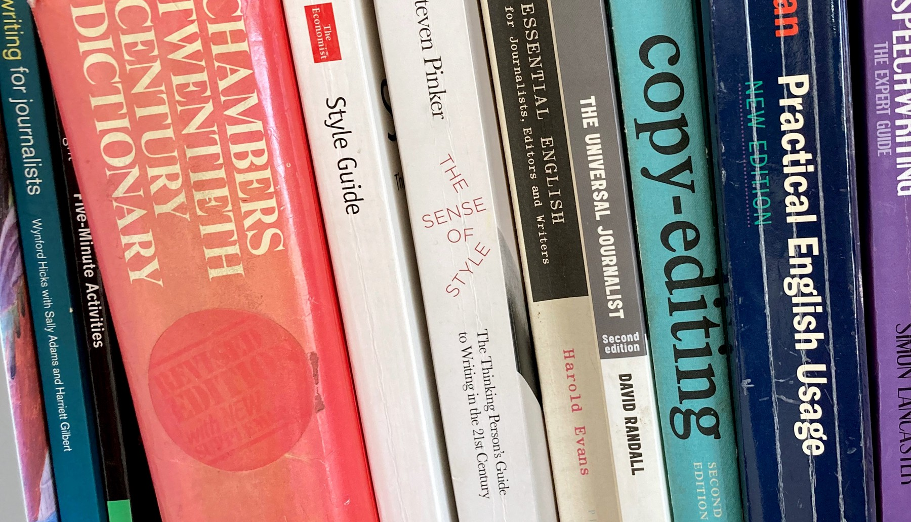 A bookshelf showing some of the writer's source books, including The Economist Style Guide, Steven Pinker's 'The Sense of Style', 'The Universal Journalist' by David Randall and titles on copy-editing and Practical English Usage.