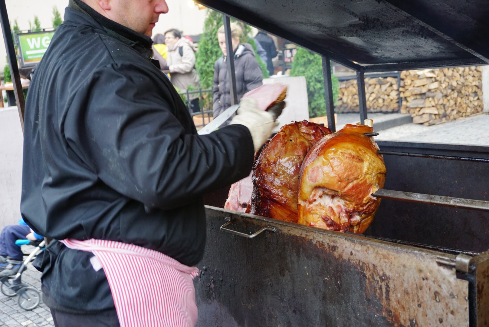 The famous Prague ham roasting on a barbeque spit