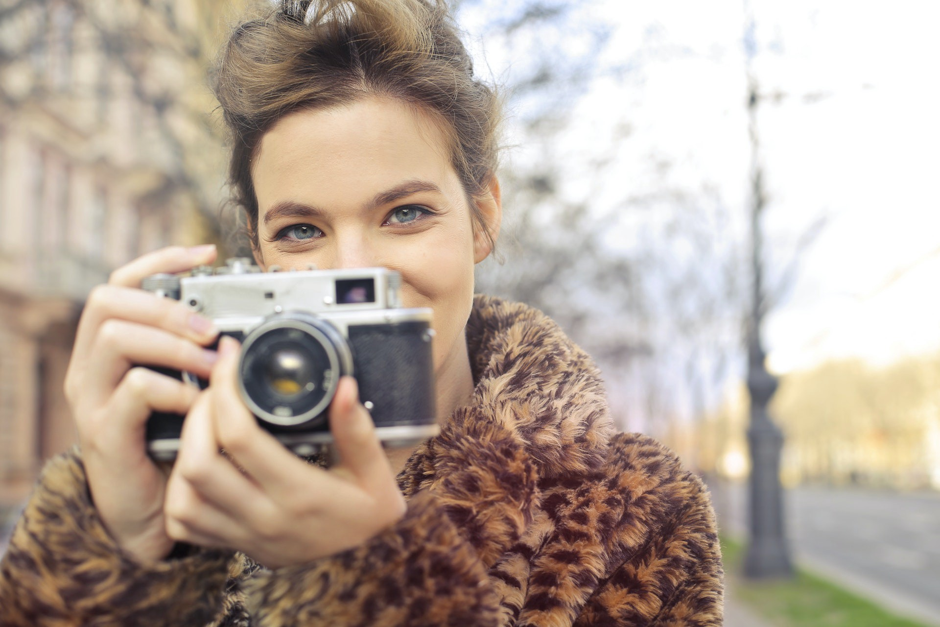 Woman holding black and gray focus camera