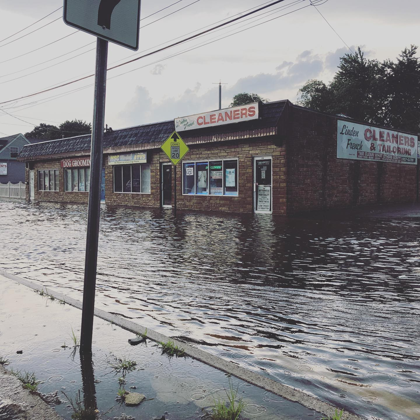 A stranded set of businesses on a main thoroughfare in North Lindenhurst, N.Y. caused by nuisance flooding in 2018. Image credit: Dan Horn