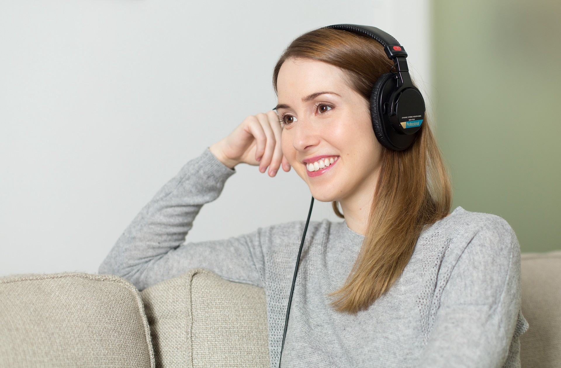 A woman listening to music on her headphones
