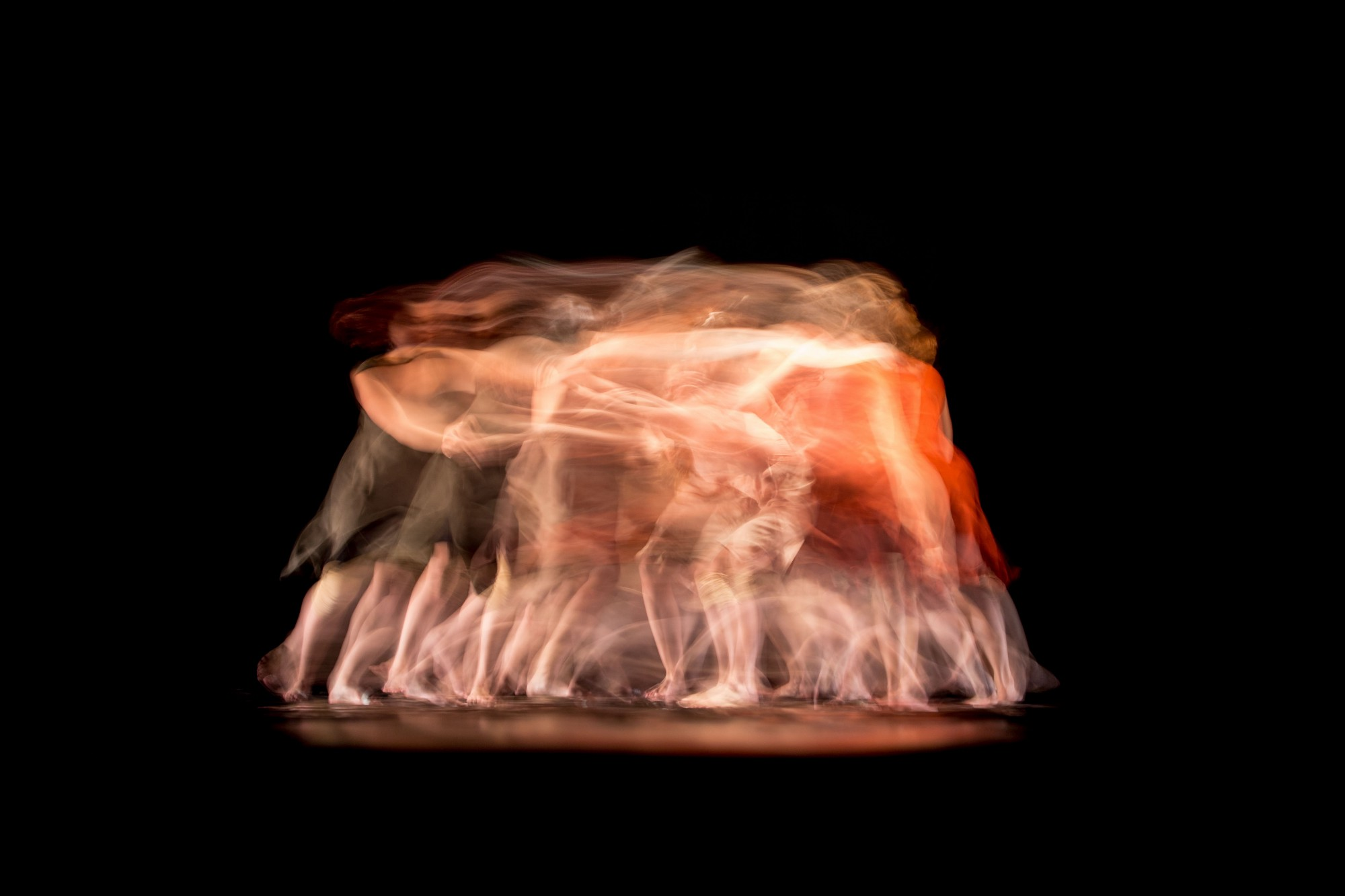 ballet dancers on stage merge in slow shutter effect