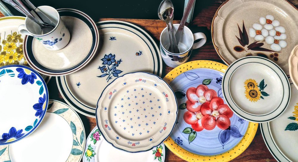 The collection of colorful floral dish ware to replace single-use plastic in the employee kitchen at Enchanted Gardens.