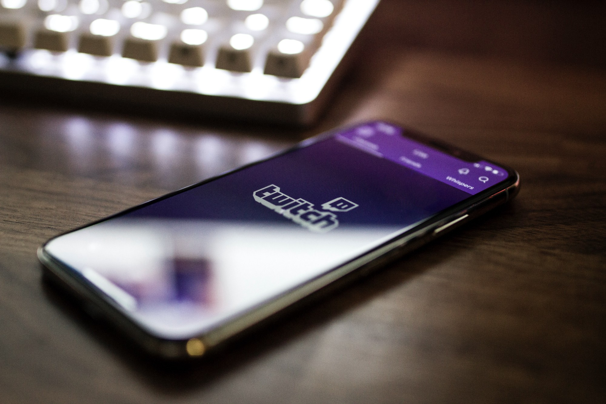 A mobile device with the Twitch logo displayed.