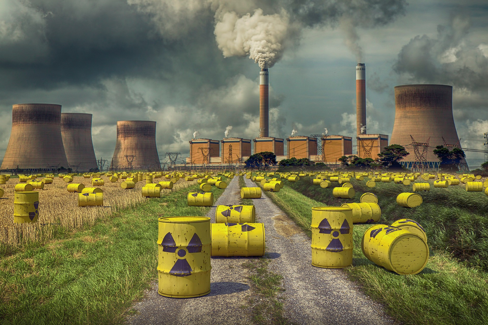 Yellow barrels with the biohazard symbol on them in front of a nuclear power plant.