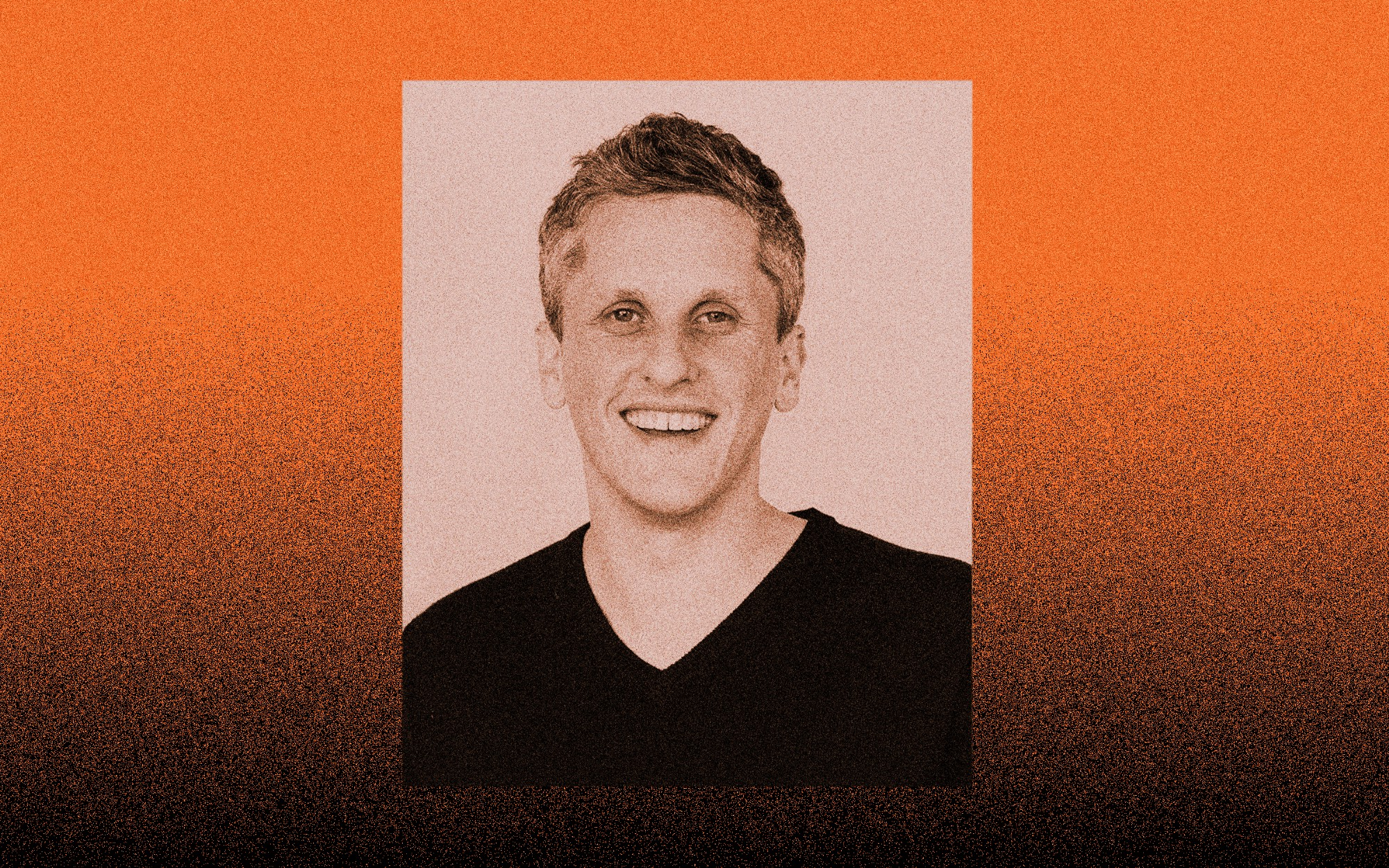 A photo of Aaron Levie against an orange gradient to black background.