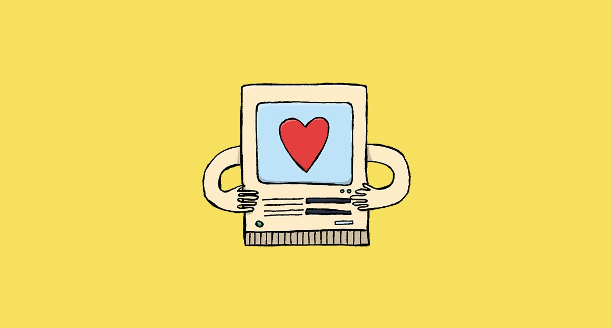 A computer with a heart on the screen.