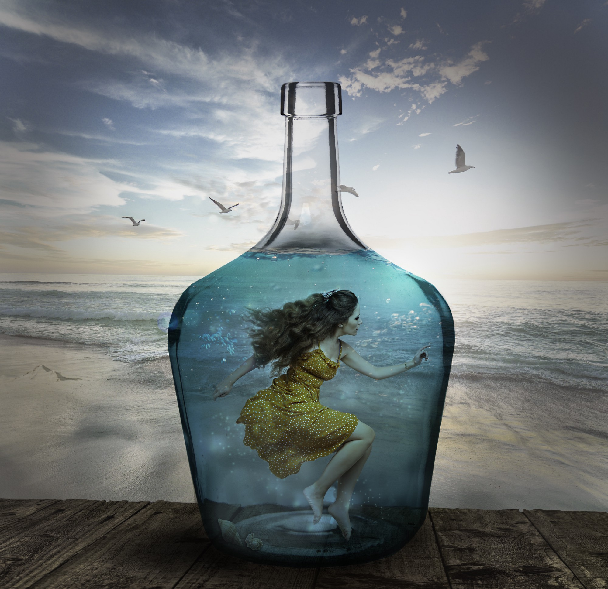 A woman is trapped inside a water-filled bottle. The beach and seagulls are in the background.