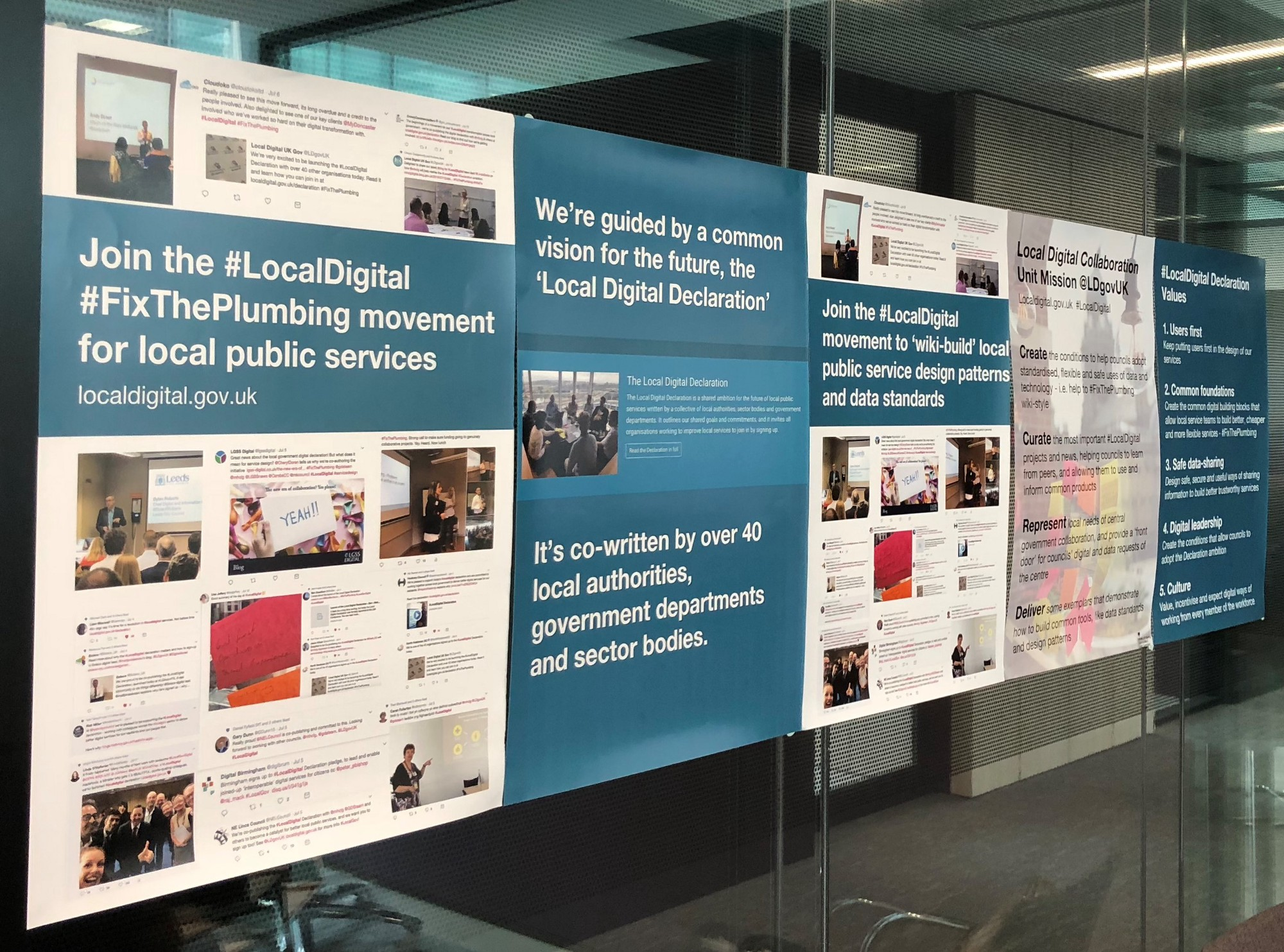 A wall of posters from the Local Digital Declaration launch in July 2018