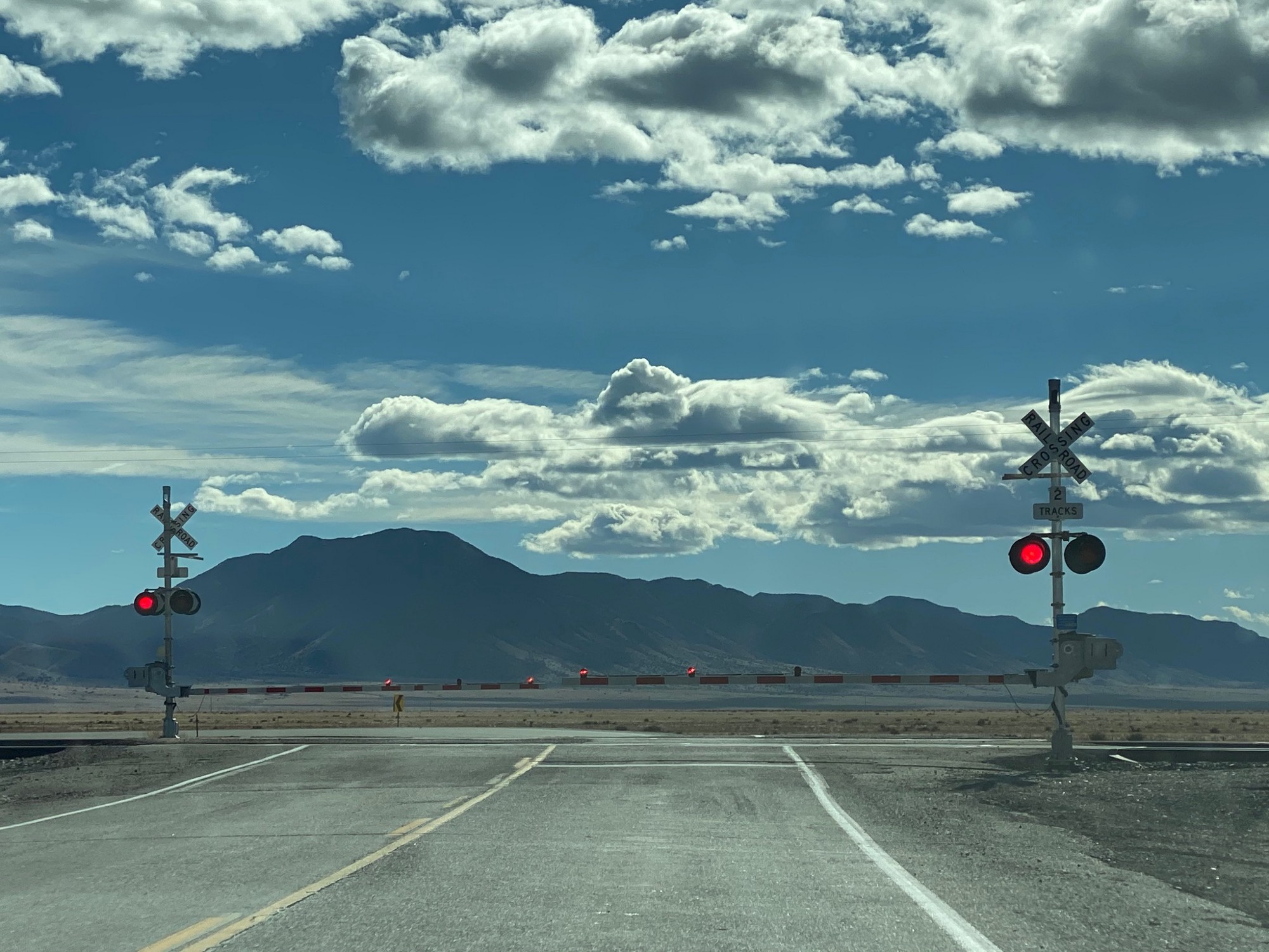 The view toward the south of a railroad crossing where NM 47 intersects with US 60 south of Belen, New Mexico
